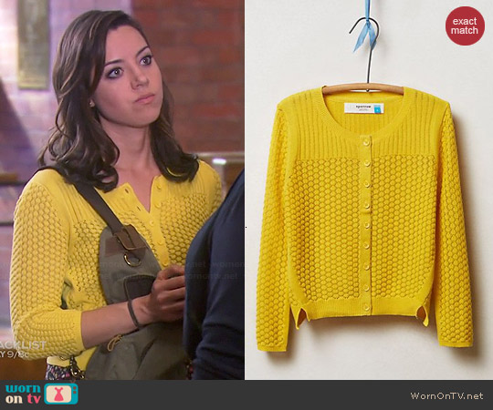 Anthropologie Pointelle Cable Cardigan in Gold worn by Aubrey Plaza on Parks & Rec