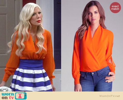Bebe Long Sleeve Wrap Bodysuit in Flame worn by Tori Spelling on Mystery Girls