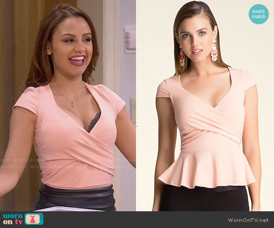 Bebe Solid Peplum Top worn by Aimee Carrero on Young & Hungry