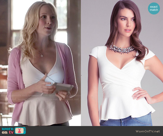 Bebe Solid Wrap Peplum Top in White worn by Candice Accola on The Vampire Diaries