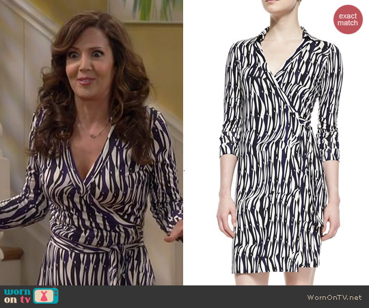 Diane von Furstenberg Jeanne Wrap Dress in Glass Weave Purple worn by Maria Canals-Barrera on Cristela