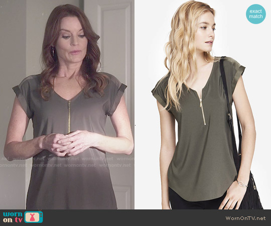 Express Mixed Texture Zip Front Tee in Olive Green worn by Laura Leighton on PLL