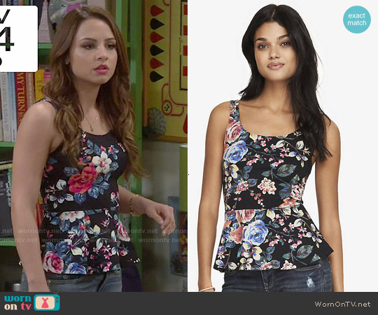 Express Rose Print Peplum Top worn by Aimee Carrero on Young & Hungry