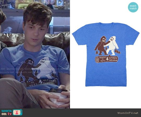 GnomEnterprises Bigfoot Vs Yeti Ultimate Throwdown Tee worn by John Karna on Scream