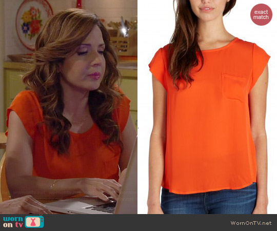 Joie Rancher Top in Spicy Orange worn by Maria Canals-Barrera on Cristela