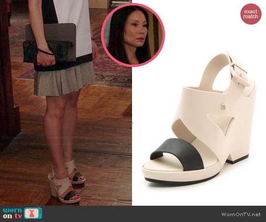 Melissa Flip Wedges worn by Lucy Liu on Elementary
