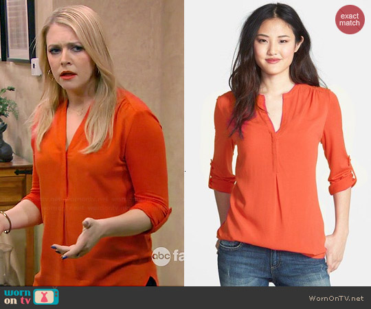 Pleione Mixed Media Tunic in Orange worn by Melissa Joan Hart on Melissa & Joey