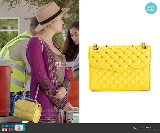 Rebecca Minkoff Mini Affair Bag in Marigold worn by Jordan Hinson on Kevin from Work
