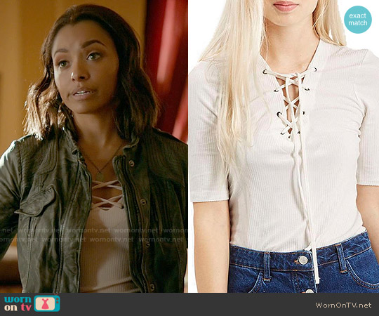 Topshop Lace Up Short Sleeve Crop Top worn by Kat Graham on The Vampire Diaries