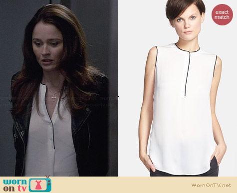 WornOnTV: Lisbon's white blouse with black trim on The