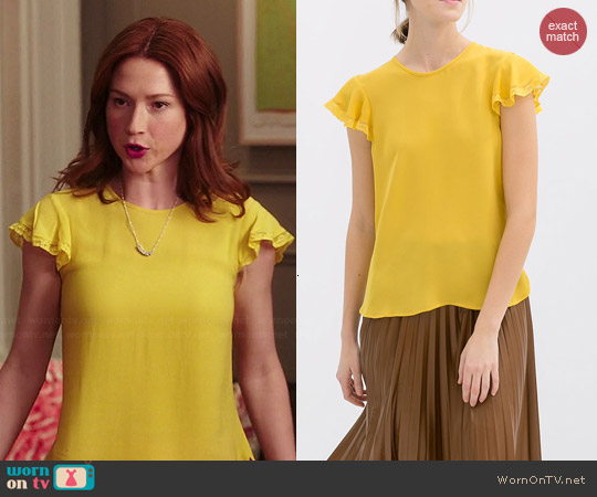 Zara Blouse with Frill and Lace Trim worn by Ellie Kemper on Unbreakable Kimmy Schmidt